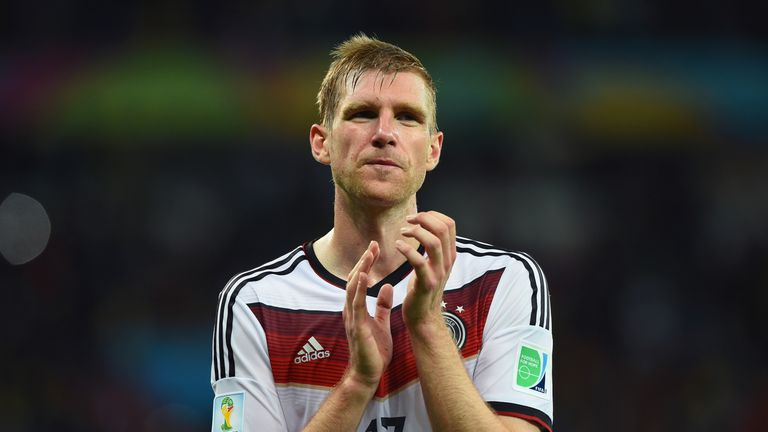 Per Mertesacker applauds the fans after Germany's World Cup win v Algeria