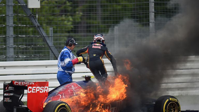 Kvyat had to make a swift exit when his Toro Rosso caught fire