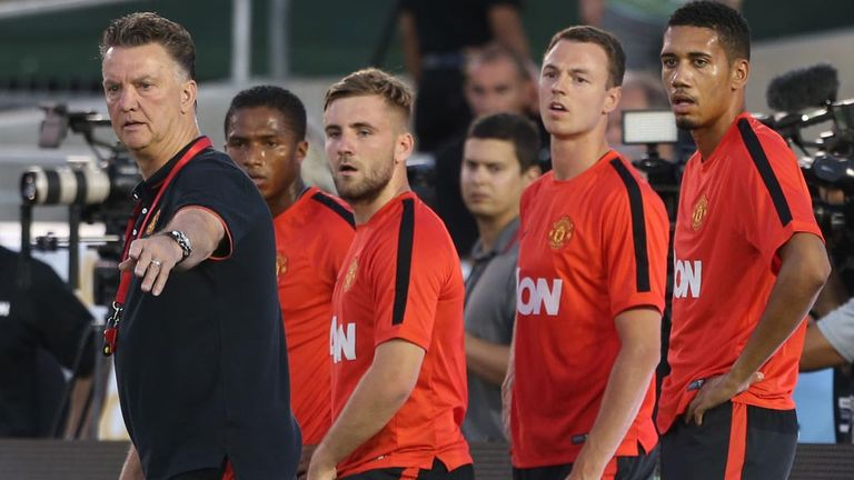 Luke Shaw stands directly behind Manchester United manager Louis van Gaal during a training session at Pasadena's Rose Bowl in California on Tuesday.