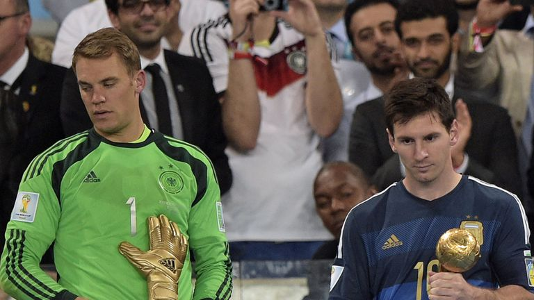 Germany's goalkeeper Manuel Neuer and Argentina's forward and captain Lionel Messi hold their respective trophies of 'Golden Glove' and 'Golden Ball'