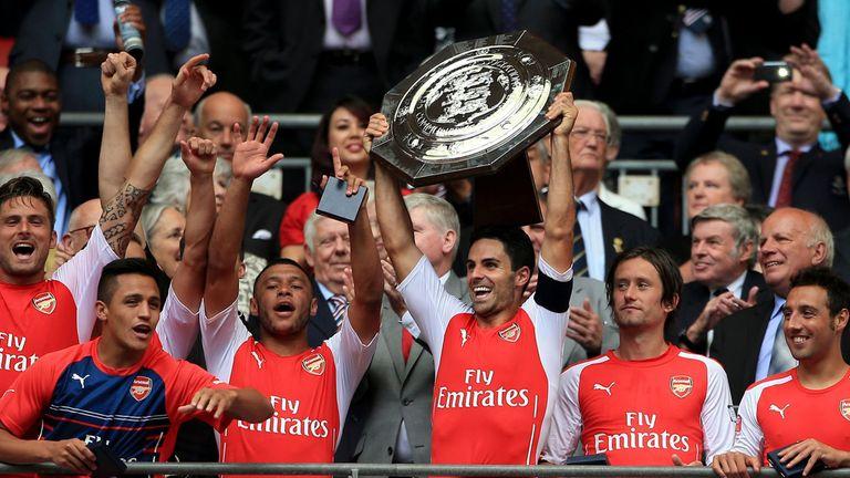 Arsenal captain Mikel Arteta lifts the Community Shield