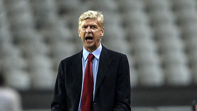 Arsenal's head coach Arsene Wenger reacts during the UEFA Champions League play-off first leg football match Besiktas vs Arsenal
