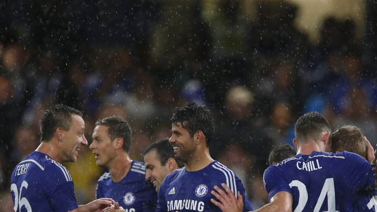 LONDON, ENGLAND - AUGUST 12: Diego Costa of Chelsea celebrates scoring his 2nd goal with his team mates during the pre-season friendly match between Chelse