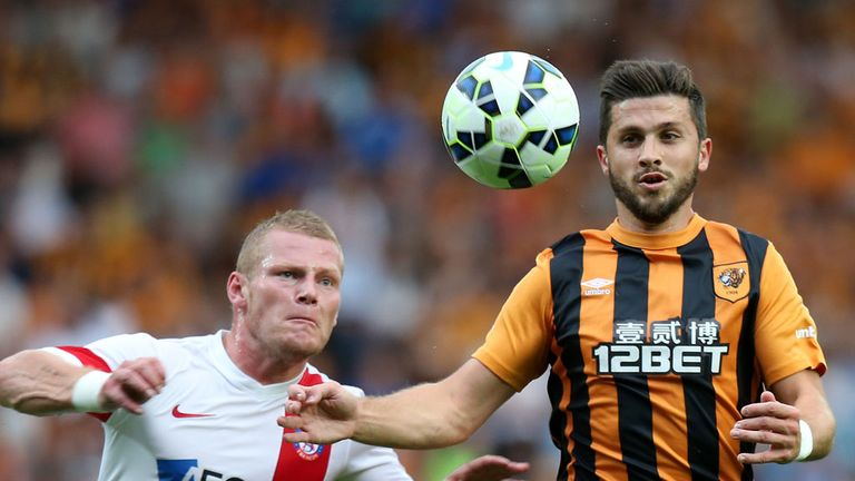 Shane Long battles with Peter Cogley
