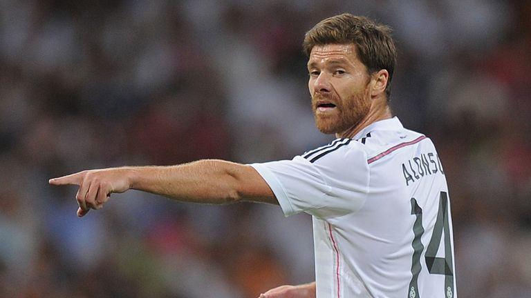 Xabi Alonso of Real Madrid reacts during the Supercopa first leg match between Real Madrid and Club Atletico de Madrid