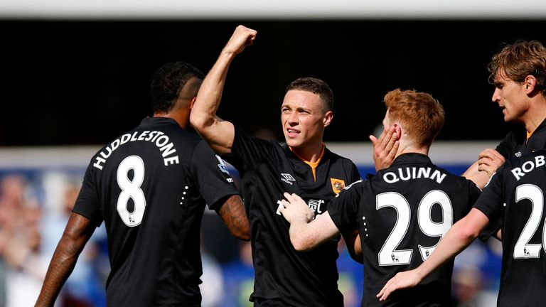 LONDON, ENGLAND - AUGUST 16:  James Chester of Hull City (2nd l) celebrates scoring the opening goal against Queens Park Rangers with teammates l-r Tom Hud