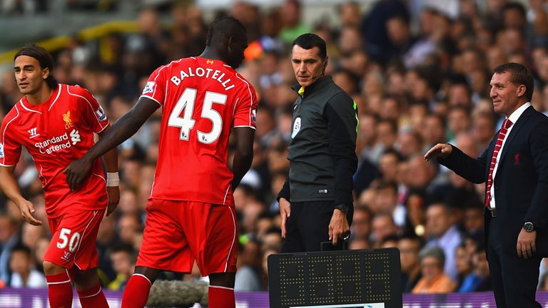 Brendan Rodgers, manager of Liverpool looks on as Lazar Markovic of Liverpool replaces Mario Balotelli of Liverpool during th