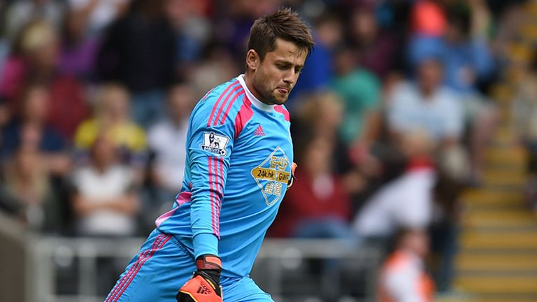 SWANSEA, WALES - AUGUST 09:  Lukasz Fabianski of Swansea City in action during a pre season friendly match between Swansea City and Villarreal at Liberty S
