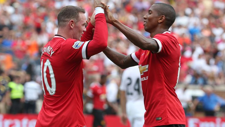 Wayne Rooney and Ashley Young celebrate as Manchester United go 2-1 up against Real Madrid