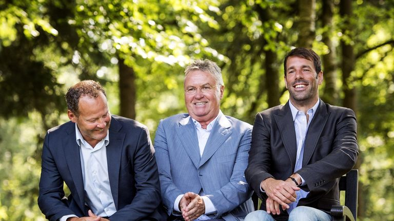 New Holland boss Guus Hiddink (c) with assistants Danny Blind (l) and Ruud van Nistelrooy (r)