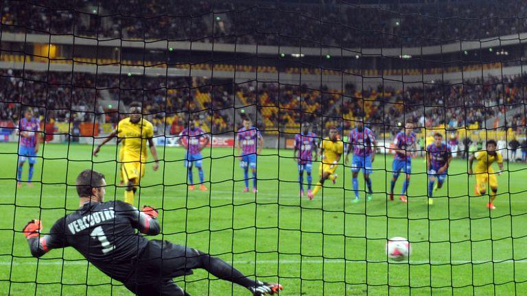 Lille's Belgian forward Divock Origi scores against Caen's French goalkeeper Remy Vercoutre