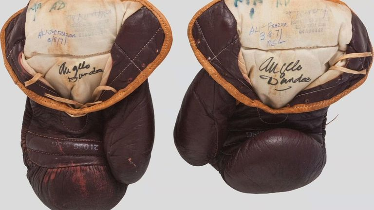 Gloves worn by Ali during the 'Fight of the Century' against Joe Frazier sold at auction in the States