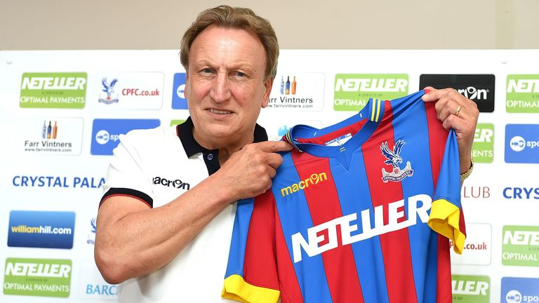 Newly appointed manager of Crystal Palace Neil Warnock poses for photographs during a press conference at training ground in Beckenham