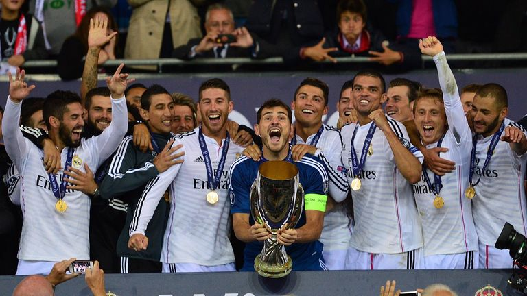 Real Madrid's goalkeeper Iker Casillas lifts the UEFA Super Cup trophy
