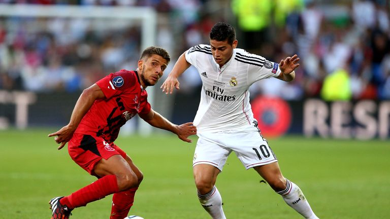 Daniel Carrico of Sevilla and James Rodriguez of Real Madrid compete for the ball during the UEFA Super Cup in Cardiff