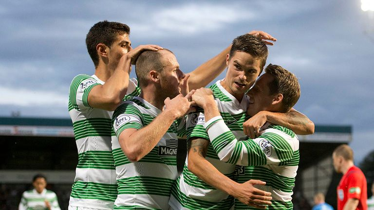Anthony Stokes: Celebrates with Celtic team-mates Nir Biton, Mikael Lustig and Kris Commons