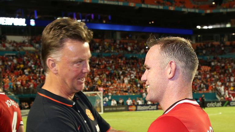 Louis van Gaal of Manchester United congratulates Wayne Rooney after the pre-season friendly match against Liverpool.