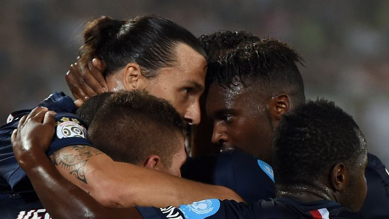 Paris Saint-Germain's Zlatan Ibrahimovic (L) celebrates his first goal against Guingamp during the French season-opening Champions Trophy football match