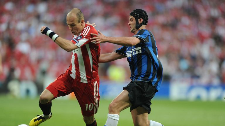 Bayern Munich's Arjen Robben and Inter Milan's Cristian Chivu vie for the ball during the UEFA Champions League final in 2010