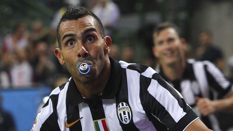 MILAN, ITALY - SEPTEMBER 20:  Carlos Tevez of Juventus FC celebrates after scoring the opening goal during the Serie A match between AC Milan and Juventus