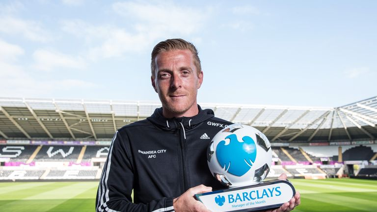 Swansea City manager Garry Monk celebrates with his Barclays Premier League Manager of the Month award