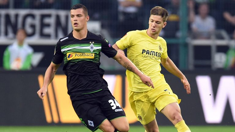 Xhaka [left] and Villarreal's Luciano Vietto
