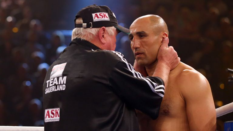 Arthur Abraham is given some instructions from his corner during his WBO super-middleweight title defence against Paul Smith in Germany