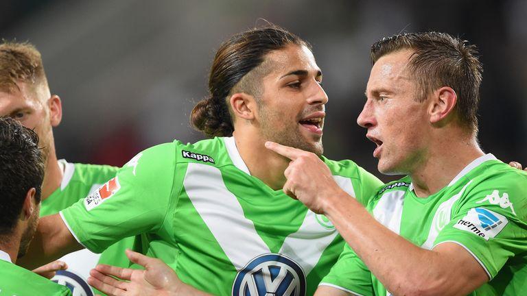 WOLFSBURG, GERMANY - SEPTEMBER 27:  Ivica Olic of Wolfsburg celebrates scoring the second goal with Ricardo Rodriguez and Vieirinha during the Bundesliga