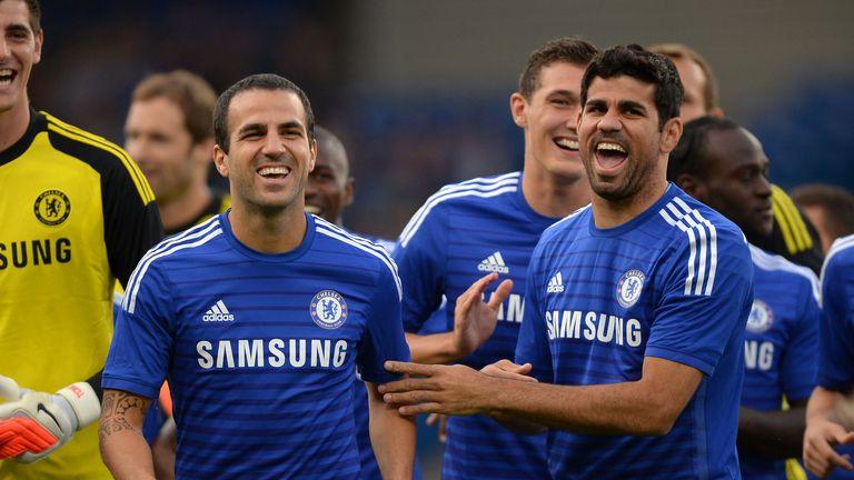 Chelsea's Cesc Fabregas and Diego Costa share a joke before a pre season friendly at Stamford Bridge, London.