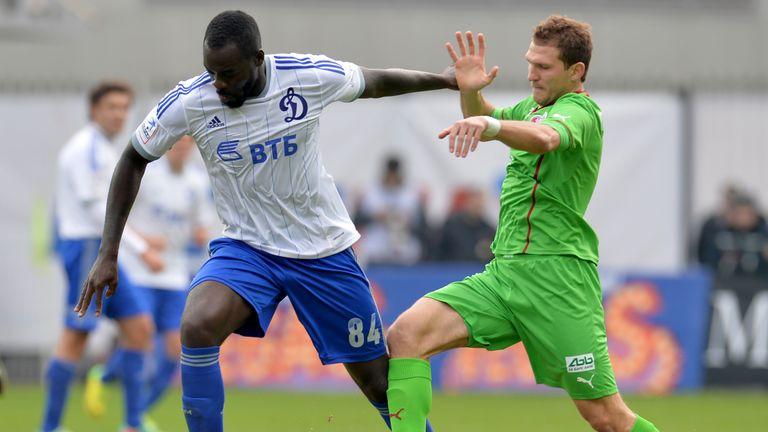 KHIMKI, RUSSIA - MARCH 23: Christopher Samba (L) of FC Dinamo Moscow challenged by Aleksandr Prudnikov of FC Rubin Kazan during the Russian Premier League