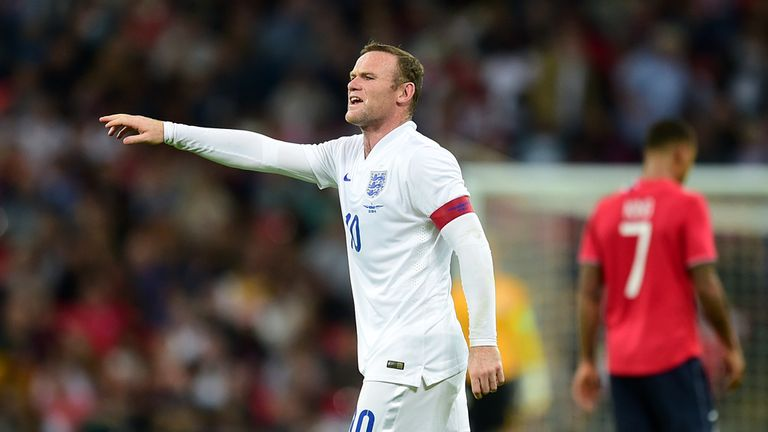 England's Wayne Rooney gestures to team-mates during the International Friendly at Wembley Stadium, London.