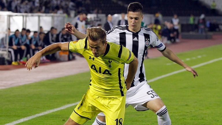 Harry Kane of Tottenham Hotspur is challenged by Danilo Pantic of Partizan