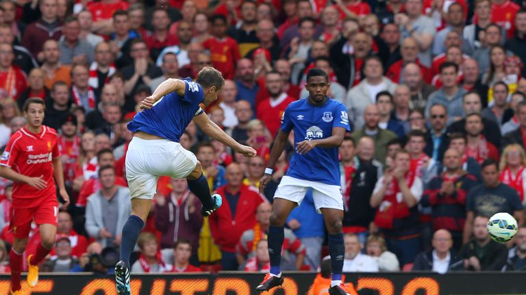 LIVERPOOL, ENGLAND - SEPTEMBER 27:  Phil Jagielka of Everton scores a late goal to level the scores at 1-1 during the Barclays Premier League match between