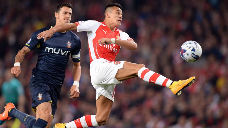 Arsenal's Alexis Sanchez (right) stretches for the ball as he gets past Southampton's Jose Fonte during the Capital One Cup Third Round match