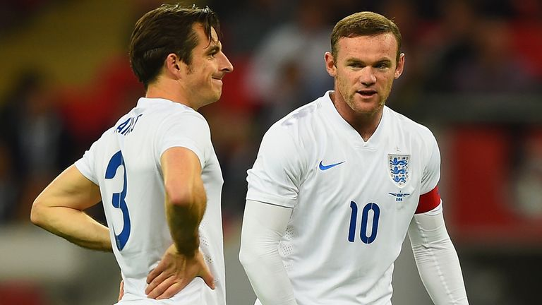 Rooney (right): In conversation with Baines