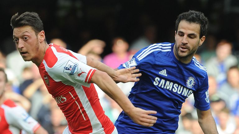 Arsenal's Mesut Ozil (left) and Chelsea's Cesc Fabregas were signed for big fees