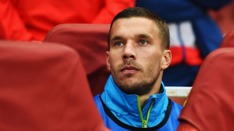 Lukas Podolski: Frustrated on the bench at Arsenal