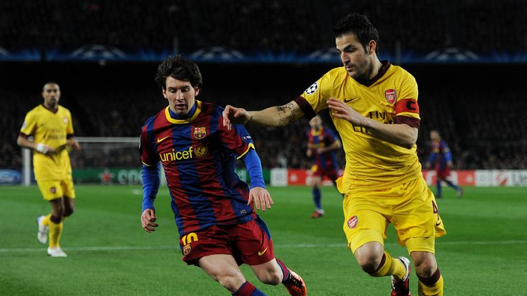 Lionel Messi of Barcelona duels for the ball with Cesc Fabregas of Arsenal during the UEFA Champions League round of 16