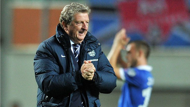 England's coach Roy Hodgson (L) walks off the pitch following the game against Estonia