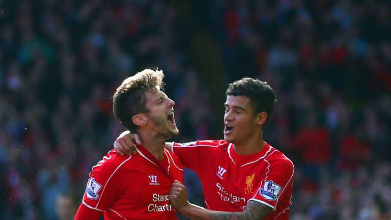 LIVERPOOL, ENGLAND - OCTOBER 04:  Adam Lallana of Liverpool is congratulated by Philippe Coutinho of Liverpool (R) on scoring the opening goal during the B