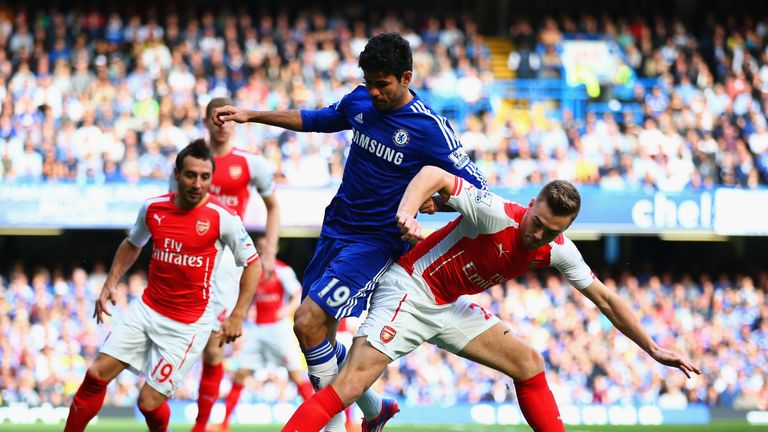 Diego Costa and Calum Chambers battle for the ball