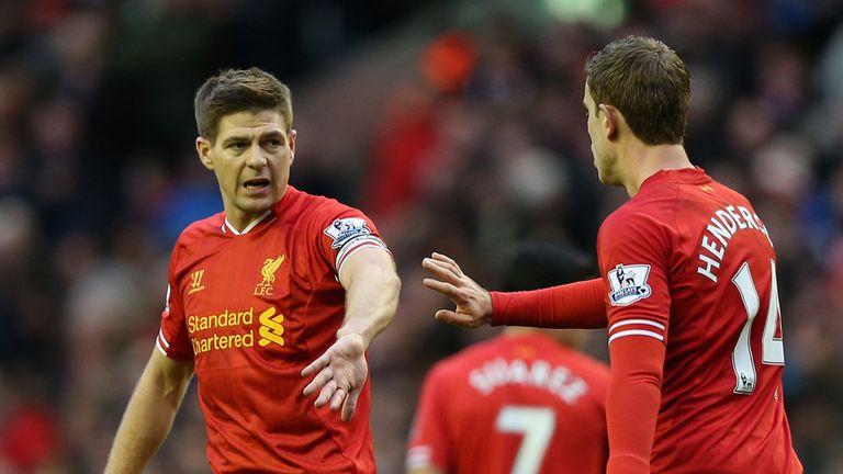 Jordan Henderson of Liverpool celebrates with Steven Gerrard