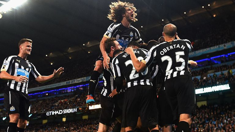 Moussa Sissoko of Newcastle United  is mobbed by team mates