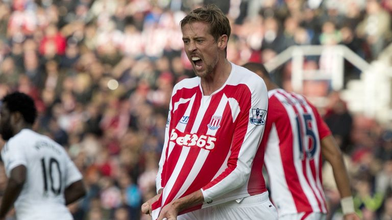 Stoke striker Peter Crouch complains about shirt-pulling