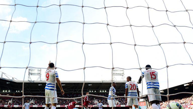 LONDON, ENGLAND - OCTOBER 05:  QPR players react after Nedum Onuoha of QPR scored an own goal during the Barclays Premier League match between West Ham Uni