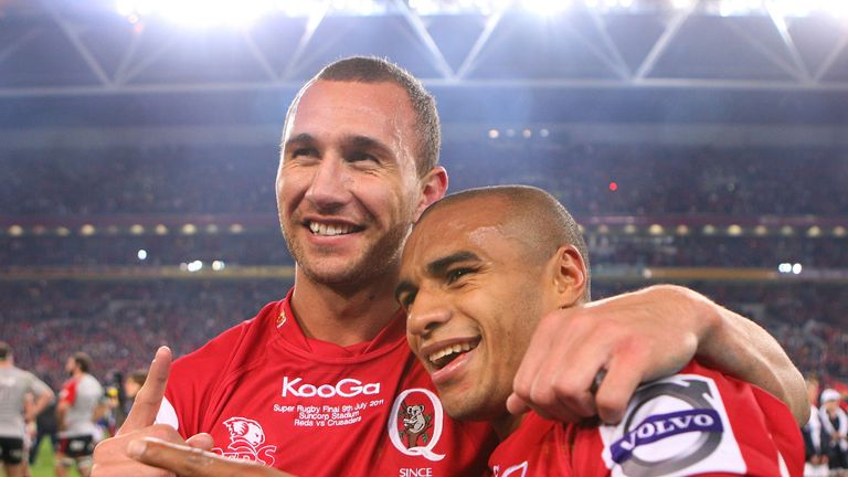 Quade Cooper and Will Genia of the Reds celebrate victory in the 2011 Super Rugby Grand Final