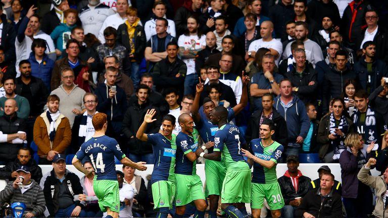 Newcastle's Sammy Ameobi celebrates with team-mates after scoring the equaliser