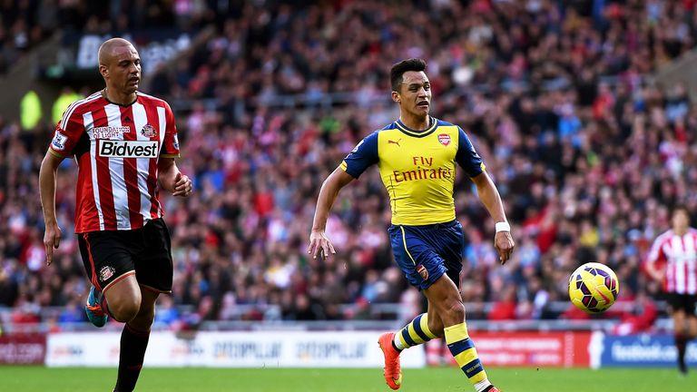 Sanchez (right) scored twice against Sunderland at the Stadium of Light last season
