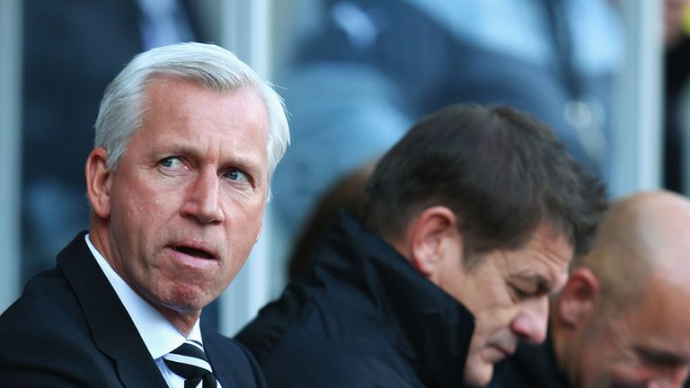 Alan Pardew looks on from the bench against Swansea