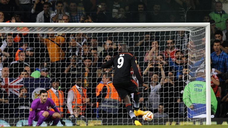 Besiktas' Demba Ba scores a penalty against Tottenham's Hugo Lloris